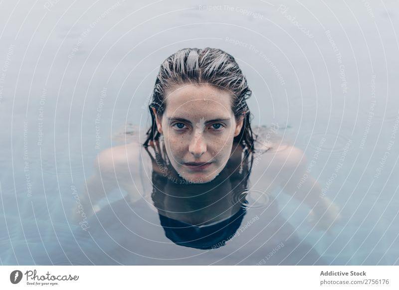 Woman looking at camera in water Lie (Untruth) Swimming Face Looking into the camera upside down Swimming pool Water Human being Summer Blue Vacation & Travel