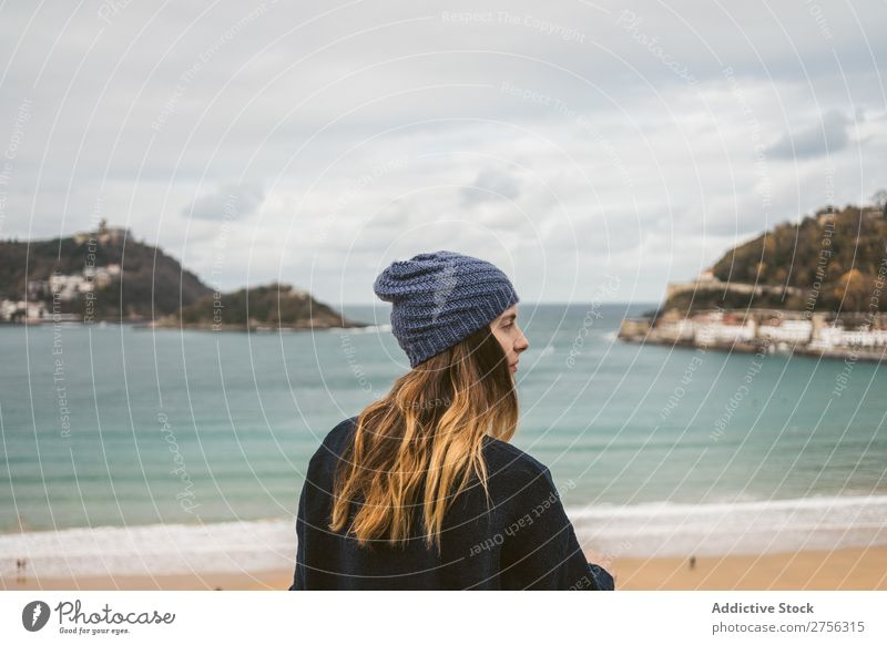 Attractive woman standing at ocean Woman Youth (Young adults) Coast Ocean pretty Hat Looking back at camera Nature Water Vacation & Travel Beach San Sebastián