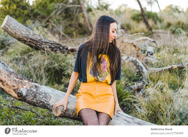 Pensive woman sitting on trunk in nature Woman pretty Nature Beautiful Portrait photograph Youth (Young adults) Beauty Photography Model Attractive Fashion