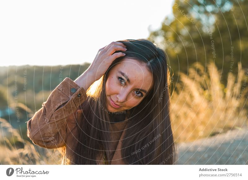 Cheerful woman playing with hair in nature Woman pretty Nature Hair Playing Beautiful Portrait photograph Youth (Young adults) Beauty Photography Model