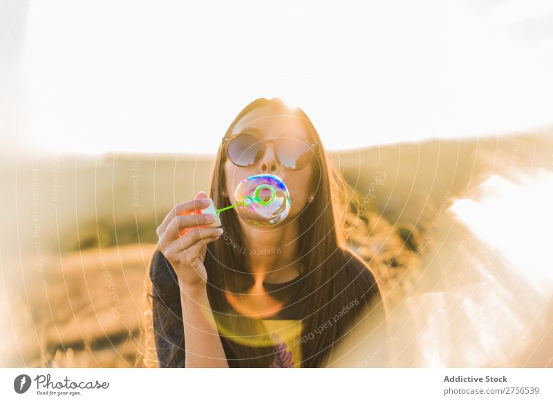 Woman blowing soap bubble in nature pretty Nature Bubble Soap Blow Sunglasses Sunbeam Beautiful Portrait photograph Youth (Young adults) Beauty Photography