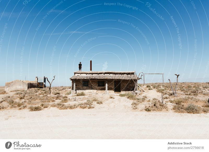 Man standing on hut roof Hut Roof Desert Vacation & Travel Lifestyle Human being Adults Nature Adventure Trip Tourist Landscape House (Residential Structure)