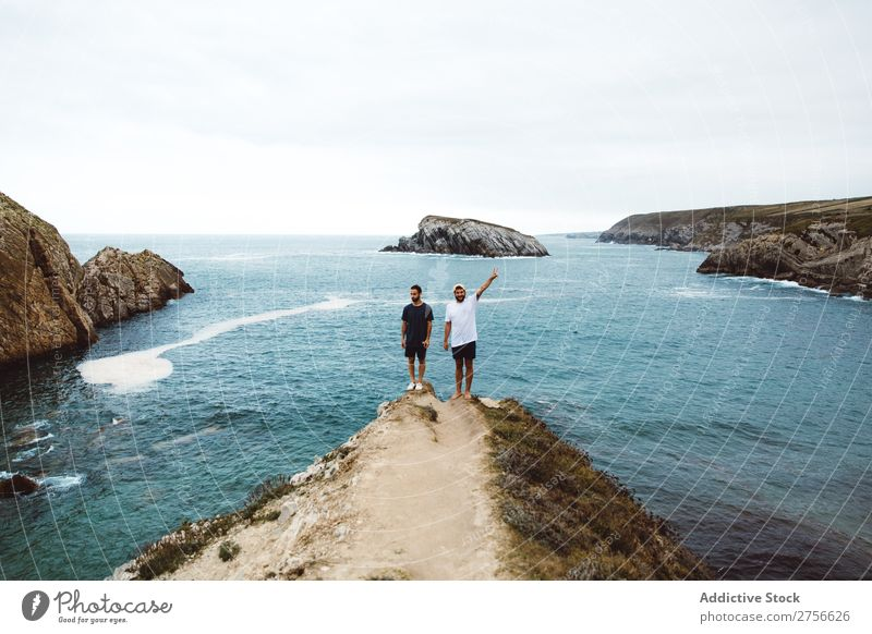 Men standing on cliff at ocean Man Tourist Ocean Rock Cheerful Friendship Together Stand Cliff Vacation & Travel Tourism Nature Landscape Coast Water Sun