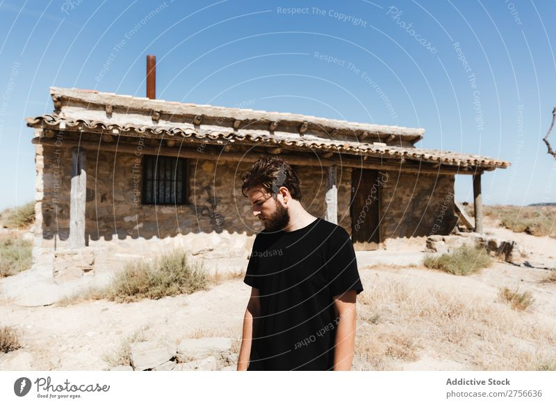 Man posing near abandoned house in the desert Desert Vacation & Travel Lifestyle Human being Adults Nature Adventure Trip Tourist Landscape