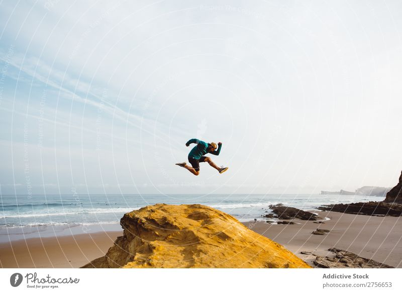 Man jumping on cliff Tourist Cliff Rock Vacation & Travel Tourism Nature Landscape Sit Rest Sun Freedom Stone Natural Lifestyle Beautiful Looking away