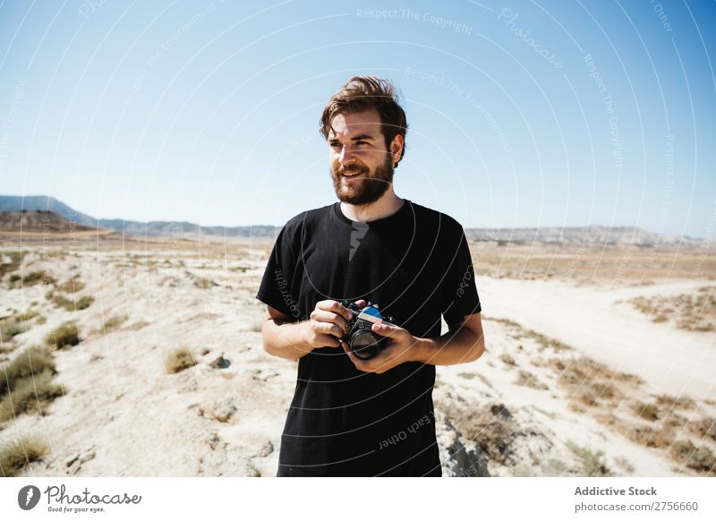 Man with camera on desert Hand Camera Illusion Trick Desert Vacation & Travel Lifestyle Human being Adults Nature Adventure Trip Hot Flying Tourist Landscape
