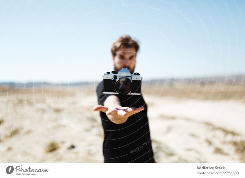 Man with camera over his hand Hand Camera Illusion Trick Desert Vacation & Travel Lifestyle Human being Adults Nature Adventure Trip Hot Flying Tourist
