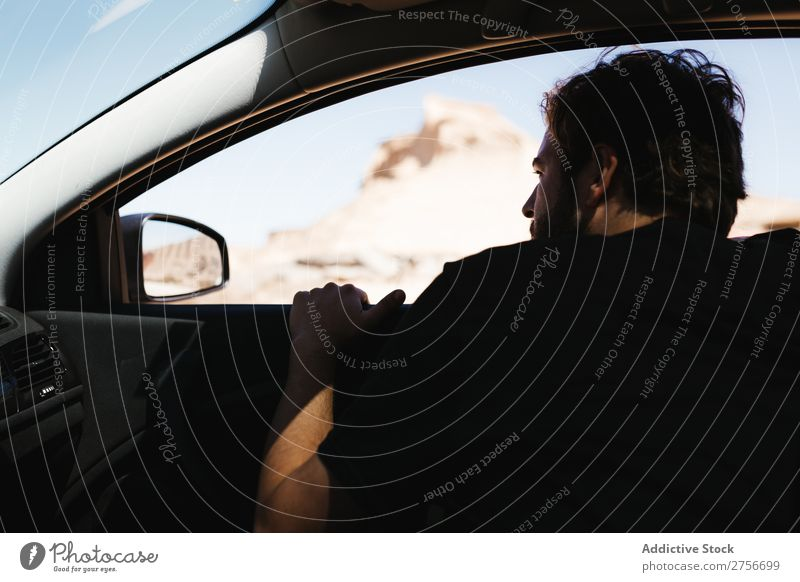 Man looking out car window Desert Window Street Vacation & Travel Lifestyle Human being Adults Camera Nature Adventure Trip Tourist Car Vehicle Landscape