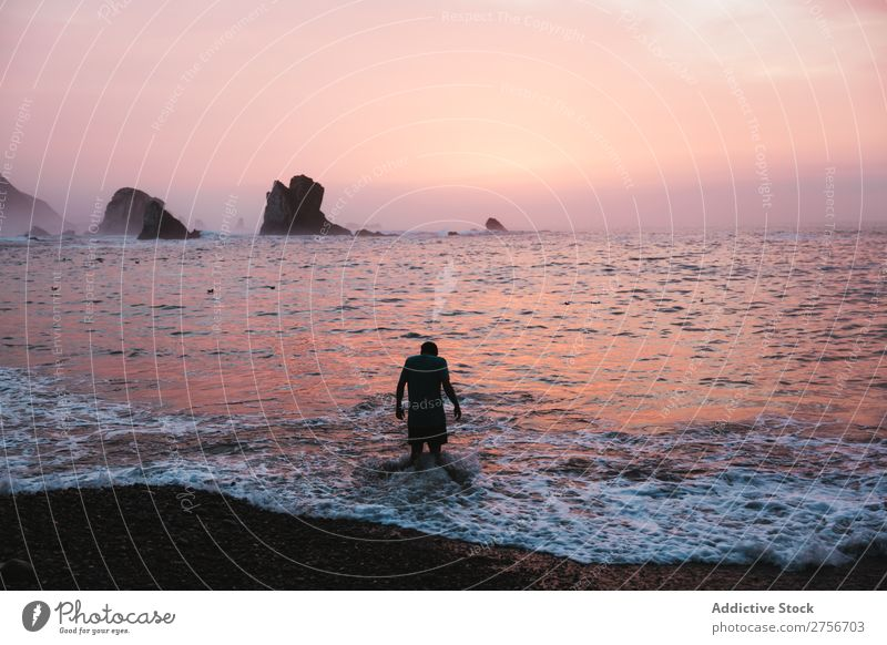 Man bathing on the beach Cliff Ocean Rock Evening Vacation & Travel Tourism Nature Landscape