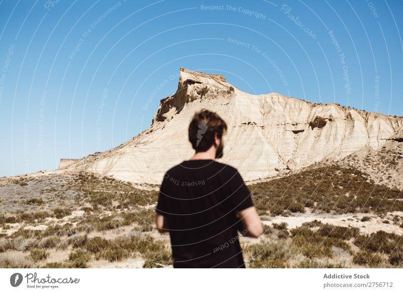 Man posing in desert Desert Vacation & Travel Lifestyle Human being Adults Nature Adventure Trip Tourist Landscape Ground Grass Stony Rock explore Beautiful