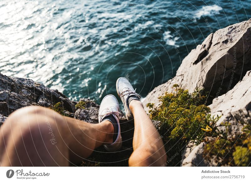 Man sitting on cliff Cliff Desert Vacation & Travel Legs Lifestyle Human being Adults Stone Rock Nature Adventure Freedom traveler Trip Tourist Hot Relaxation