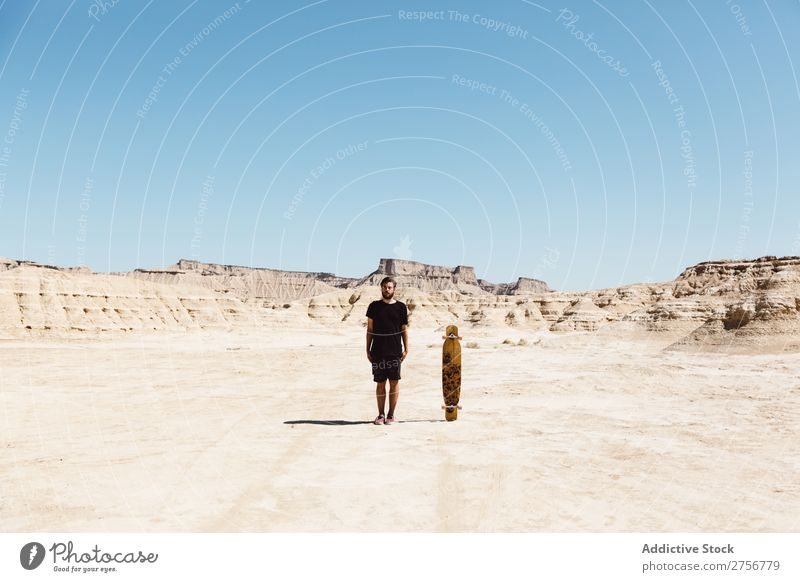 Man standing near skateboard Skateboard Desert Vacation & Travel Lifestyle Human being Adults Nature Adventure Trip Tourist Sports Action Extreme Cliff Hill