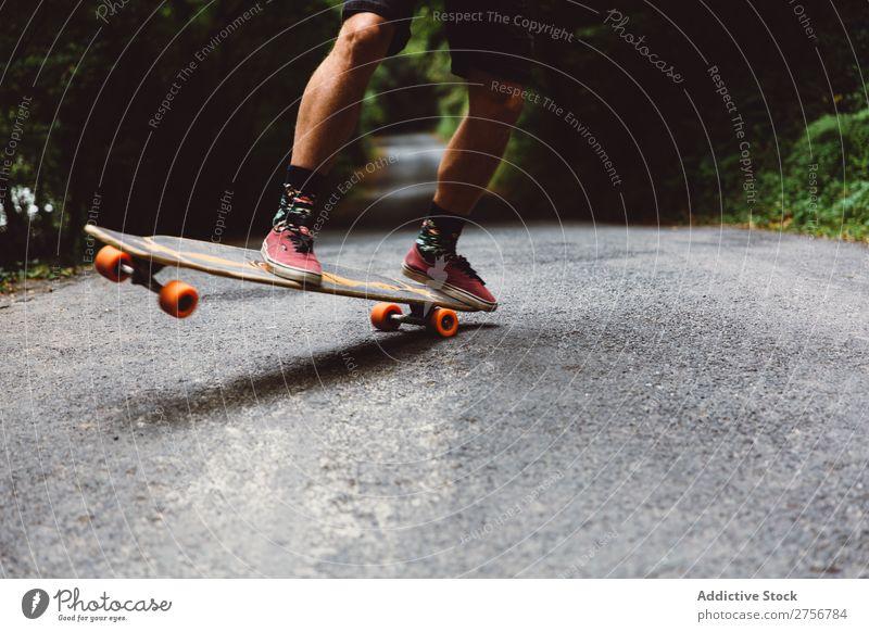 Crop man on skateboard on forest road Man Skateboard Forest Joy Ice-skating Human being Sports