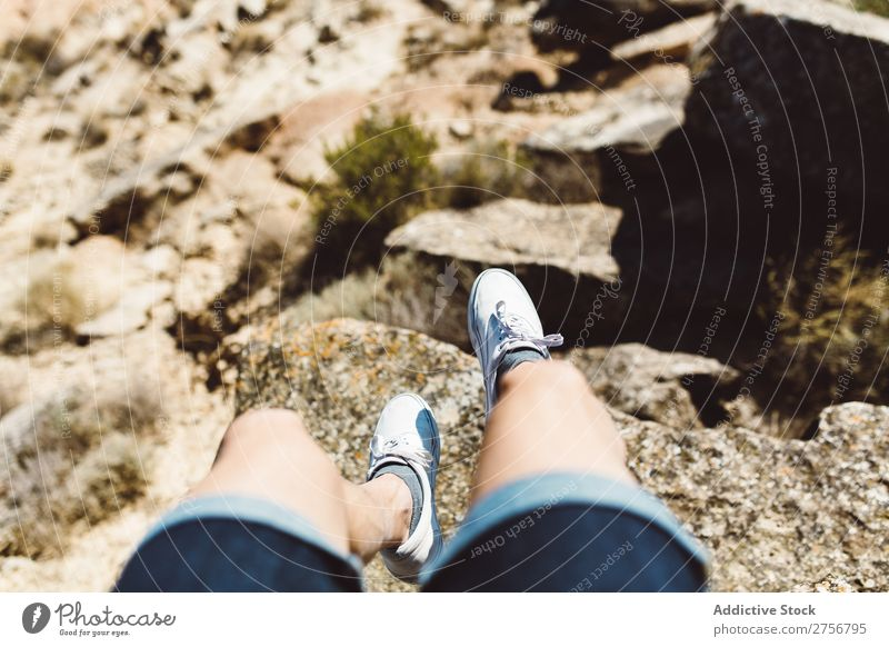 Man sitting on cliff Cliff hanging over Desert Vacation & Travel Legs Lifestyle Human being Adults Stone Rock Nature Adventure Freedom traveler Trip Tourist Hot