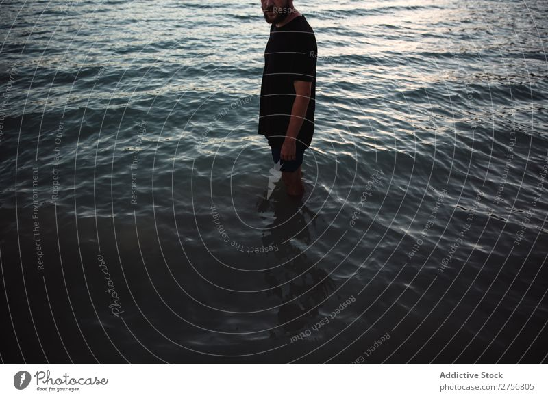 Man standing in water Water knee-deep Human being Vacation & Travel Nature Relaxation Ocean Lake Resting Waves Calm tranquil Serene Peaceful Dark Deep Wet Cold