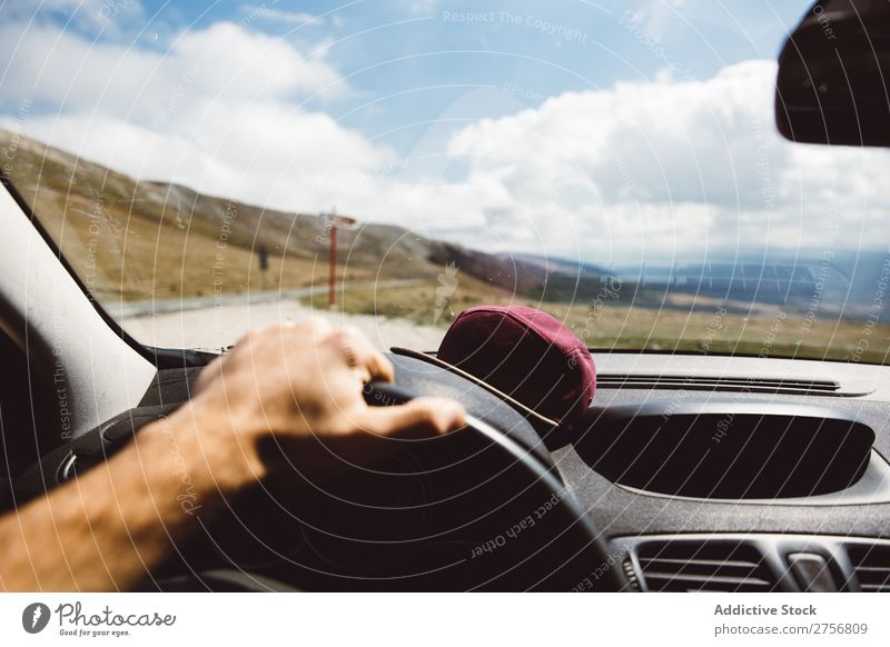 Man driving car in hills Human being Driving Car Street Hill Mountain Peak Nature Vacation & Travel Vantage point Picturesque Slagheap Landscape Height Rock