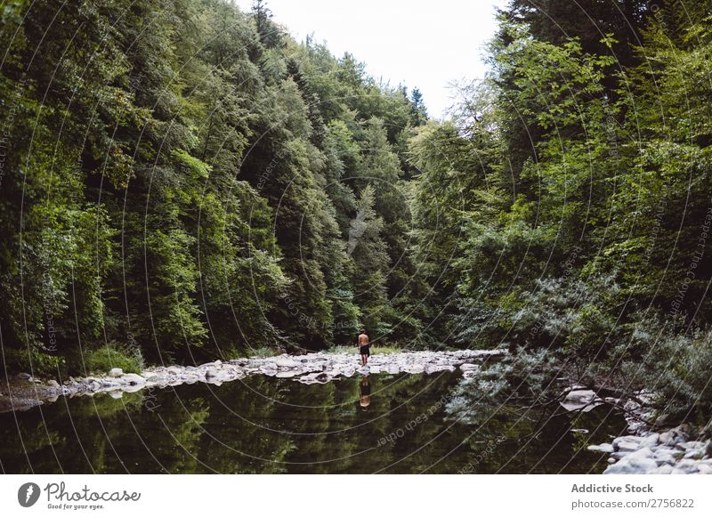 Man standing in a river Tourist Hiking River Pond Vacation & Travel Nature Adventure Trip Human being Lifestyle Tourism Leisure and hobbies trekking Action