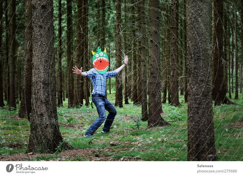 Jazzhands! Playing Trip Human being 1 Tree Moss Forest Shirt Jeans Mask Dance Romp Happiness Funny Monster Colour photo Multicoloured Exterior shot Day