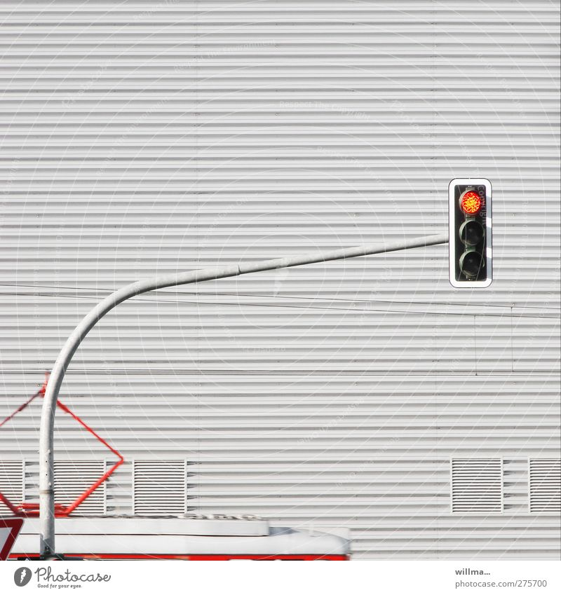 The traffic light is on red Traffic light Tram house wall Transport Means of transport Public transit Train travel Rail transport Gray Red Stop Stop signal Arch