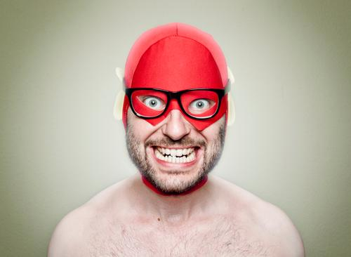 SUPERHERO Human being Masculine Young man Youth (Young adults) Man Adults 1 30 - 45 years Observe Smiling Red Hero Eyeglasses Person wearing glasses Freak Crazy