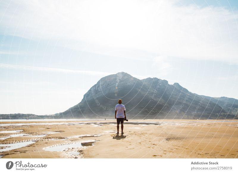 Man standing on beach Sand Beach Wet Summer Ocean Vacation & Travel Nature Human being Sunlight Leisure and hobbies Relaxation Tropical seaside Sunbeam Tourist