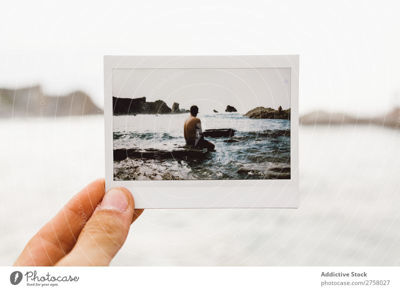 Hand with shot of man on shore Man Tourist Cliff Shot instant Ocean Rock Vacation & Travel Tourism Nature Landscape Coast Water Sun Freedom Stone Natural