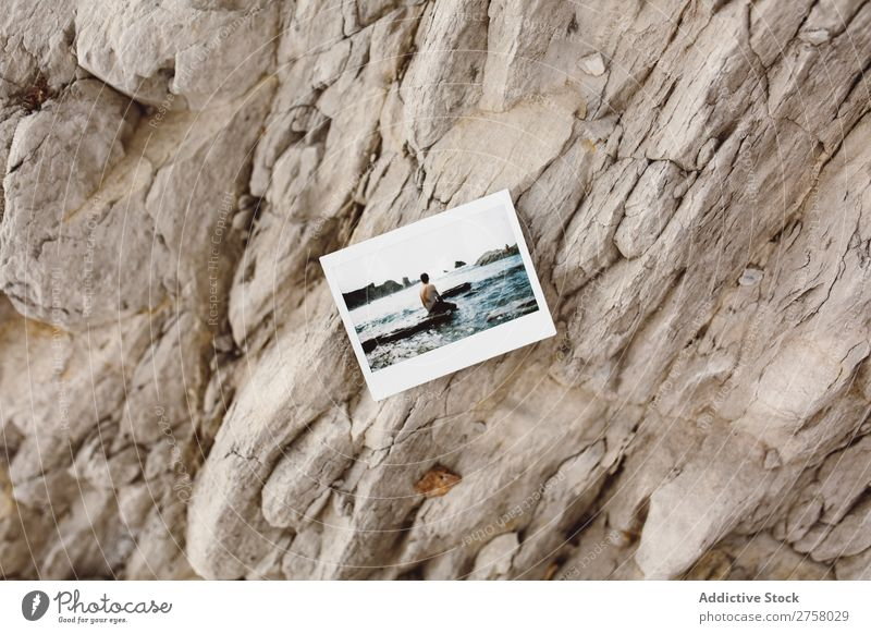 Photo on rocks Man Tourist Cliff Shot instant Ocean Rock Vacation & Travel Tourism Nature Landscape Coast Water Sun Freedom Stone Natural Lifestyle Beautiful