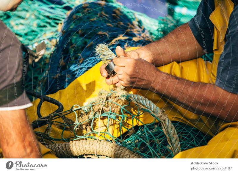 Man working with fishing net Ball bobber Buoy Colour Multicoloured Day Detail Equipment fisher Fishery fishnet Float in the water floats Horizontal Industrial