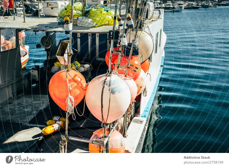 A boat with different floats Blue Watercraft bobber Buoy Calm Colour Multicoloured Equipment Europe Fishery Float in the water Harbour Horizontal Industrial