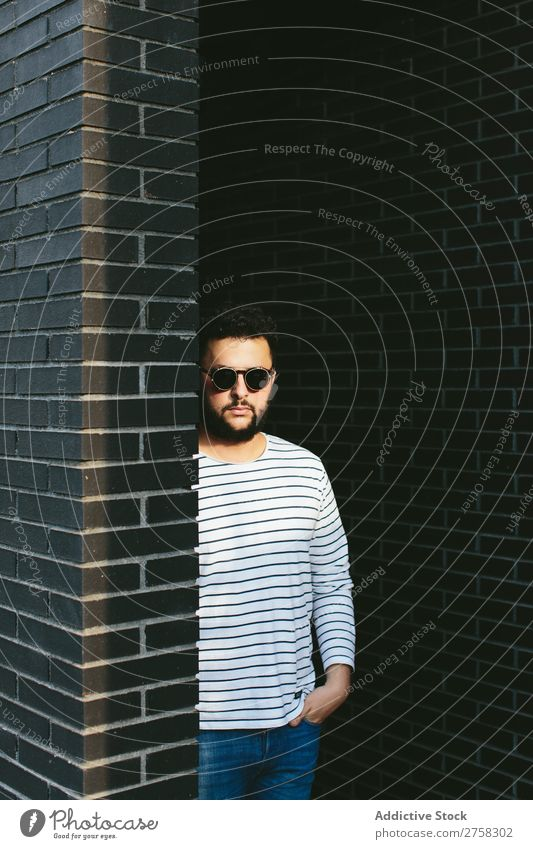 Confident man wearing stylish sunglasses Man Sunglasses Looking into the camera Considerate Pensive Style Brick Wall (building)