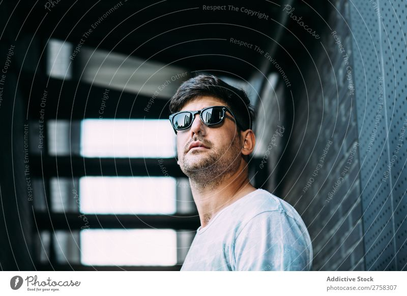 man in sunglasses cheerful smiling happy confident young cool person portrait modern model fashionable male serious casual handsome guy adult caucasian posing