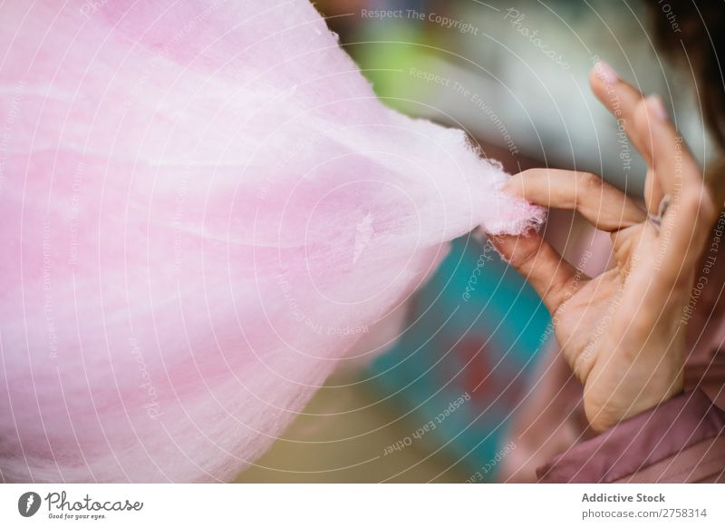 Person taking a piece of cotton candy Human being Cotton candy Pink Piece Sweet Park Food To feed Sugar Joy Hand Crops Lifestyle Portrait photograph