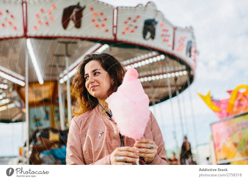 Cheerful woman with candy floss Woman Park Cotton candy Merry-go-round Human being Pink pretty Sweet Food To feed Sugar Joy Lifestyle Portrait photograph