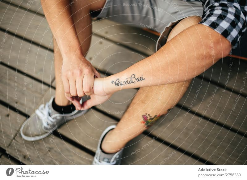 Man with tattoos sitting on wooden floor Tattooed Sit Shorts Lifestyle Youth (Young adults) Attractive Sneakers outfit Story Anonymous Unrecognizable Guy