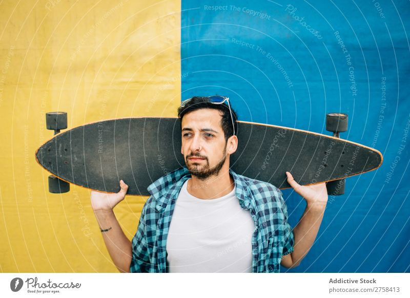 Bearded man holding skateboard Man Skateboard Youth (Young adults) Background picture Sports skateboarder Skateboarding Ice-skates Lifestyle Town Board Modern