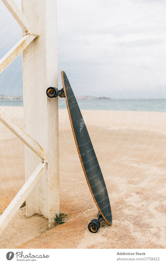 Longboard on beach Vacation & Travel Sun Sky Beautiful Deserted Exterior shot Copy Space Wooden wall Skateboard Coast Beach Leisure and hobbies Summer Sports