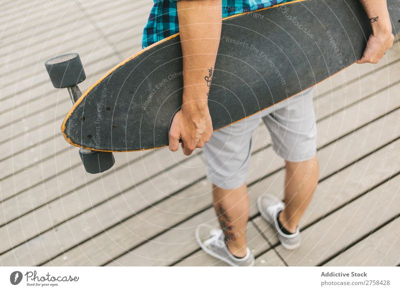 Closeup of man holding a longboard Skateboard Coast Beach Man Leisure and hobbies Summer Multicoloured youngster Action Youth (Young adults) Sports Ice-skates