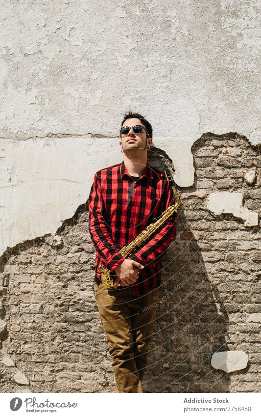 Cool musician with saxophone Musician Man Sunglasses Self-confident Cool (slang) Wall (building) Youth (Young adults) Jazz Saxophone instrument Musical