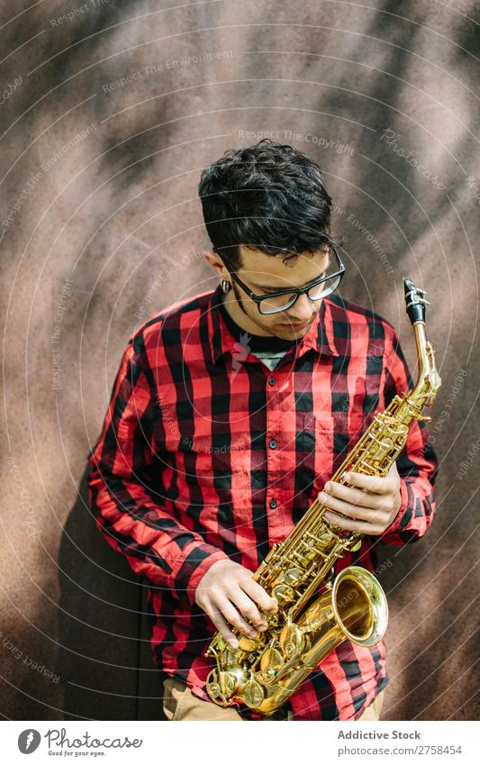 Young musician with sax Musician Man Youth (Young adults) Jazz Saxophone instrument Musical Performance Saxophon player Human being Player Acrobat Entertainment