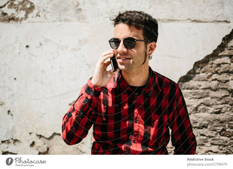 Stylish man talking phone Man PDA To talk Wall (building) Sunbeam Mobile handsome Style Cool (slang) Telephone Portrait photograph Lifestyle Communication
