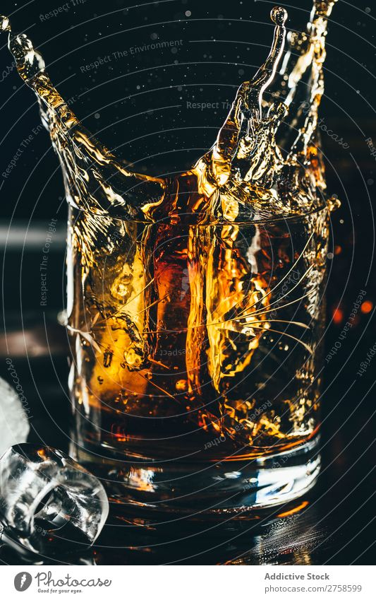 Splashes of glass of whiskey Alcoholic drinks Beverage Bourbon Brown Cocktail Cold Cool (slang) Crystal Cube Dark Drinking Drop Elegant Glass glassware Ice