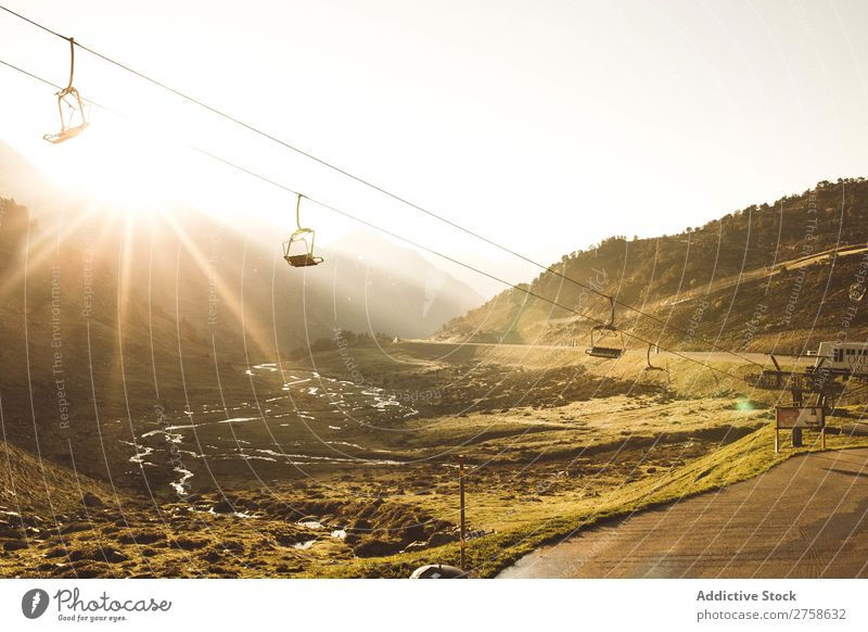 Cableway in sunny mountains Hill Mountain Nature Landscape Rock Vacation & Travel cableway ropeway Sunbeam Sunset Evening Beautiful Vantage point Summer Tourism