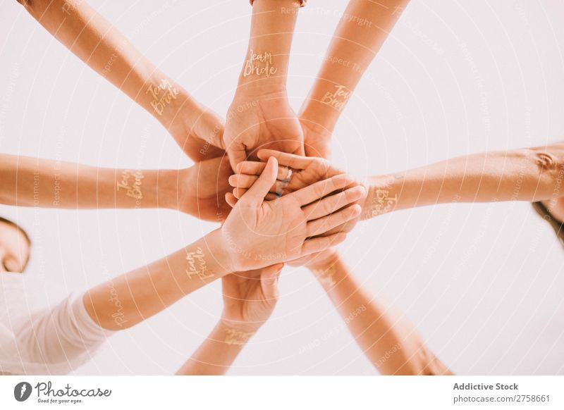 Hands of cheering people in circle Applause Team Bride Group Human being Teamwork Together Business partnership Cheerful cooperation Friendship Success