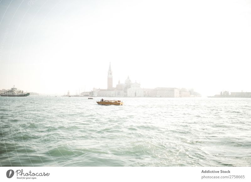 Small boat sailing in water Channel Water Watercraft Sailing City Building Architecture Tourism