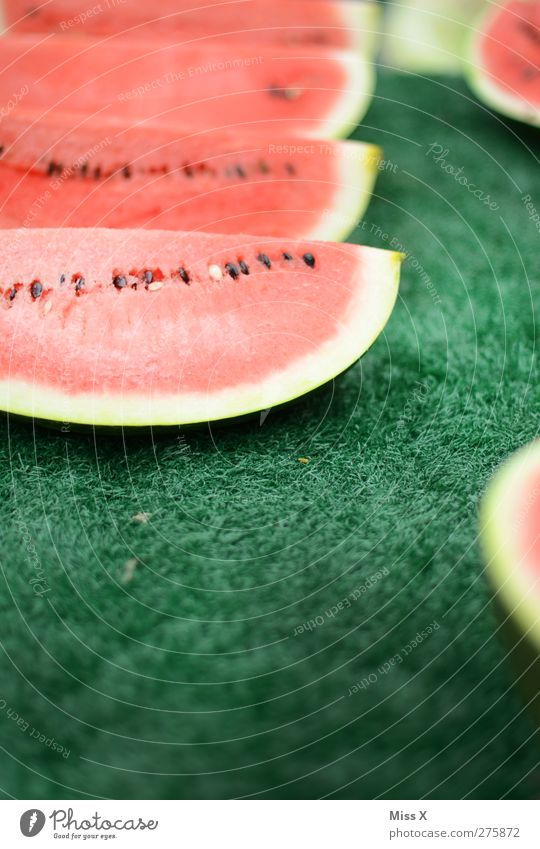 bite through Food Fruit Nutrition Organic produce Delicious Juicy Sweet Green Red Melon Water melon Part Slice Fruit seller Farmer's market Colour photo