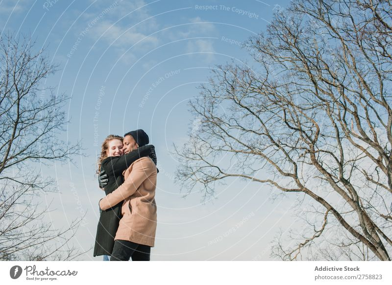 Couple embracing at naked trees Style Street Tree Leafless Naked Easygoing Beautiful