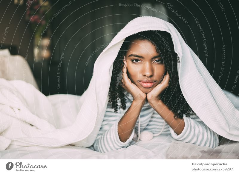Beautiful serious thoughtful and sad black woman covering her head with sheet in bed Woman Bed Sadness Anger Black Covered Covering