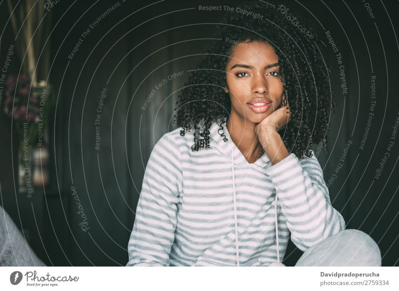 close up of a pretty black woman with curly hair smiling sit on bed looking at the camera Woman Bed Portrait photograph Close-up Sit Black Smiling African