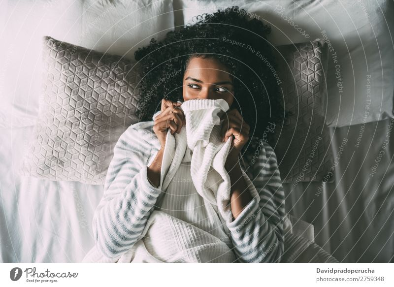 Pretty black woman covering her mouth with the sheet looking away Woman Bed Black Sheet Covering African Crops pretty Beautiful Bird's-eye view Close-up