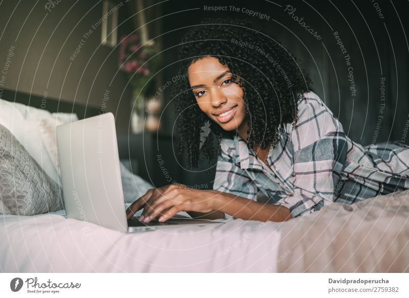 beautiful black woman on bed with laptop and cup of coffee Woman Bed Notebook Computer Smiling Portrait photograph Close-up Technology Internet wifi device